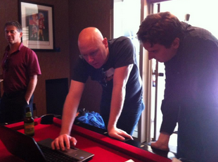 Dan and Naap check their scores while at the RG Party in Vegas